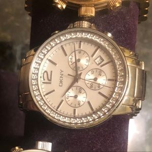DKNY silver watch with round face diamond bezel